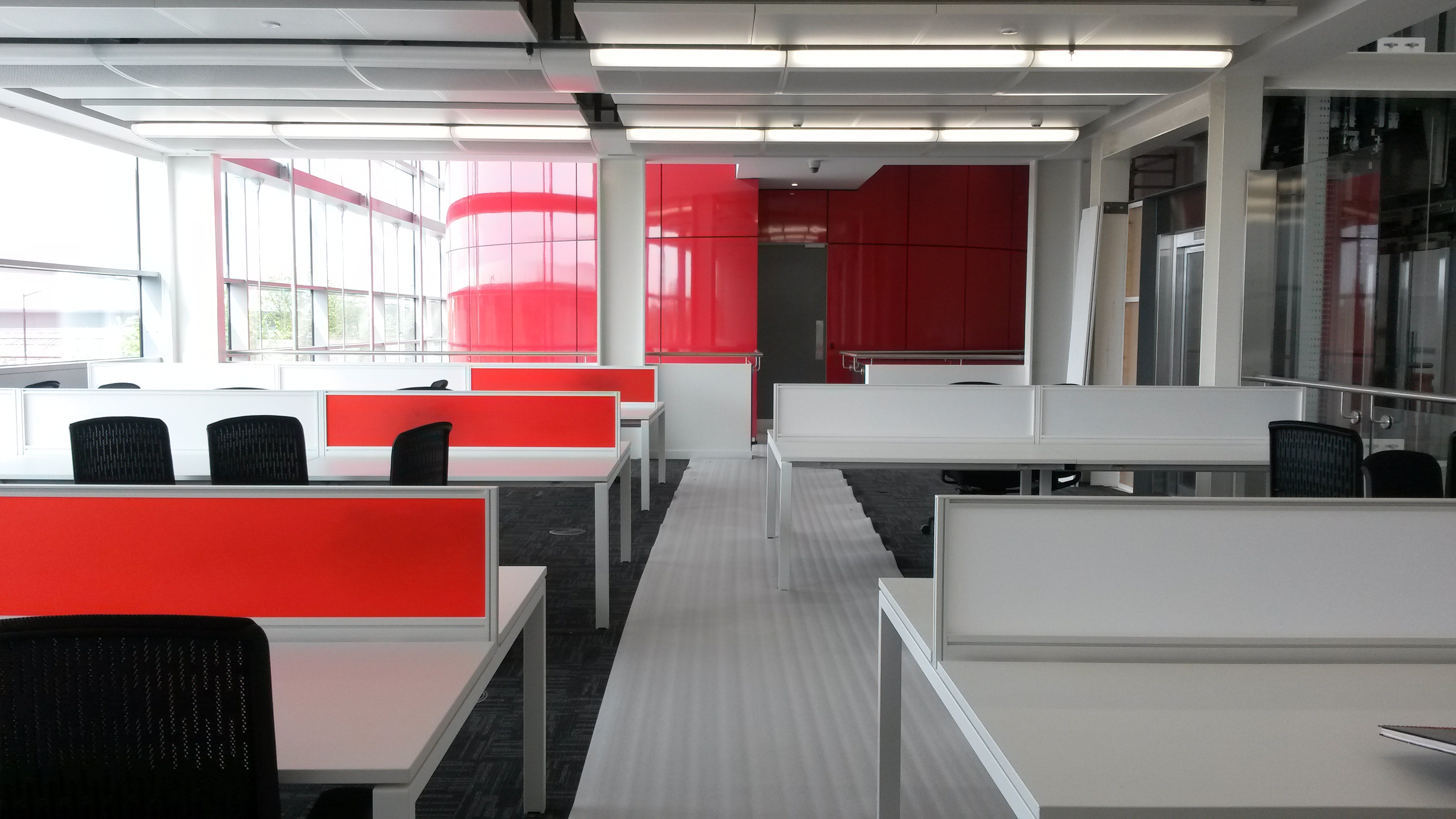 the inside of an office block done in red black and white