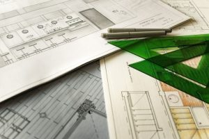 What Does an Architect Do - Building Plans Underneath Green Rulers